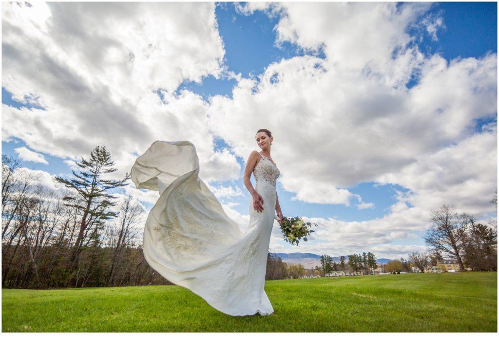 Briden's dress flowing in breeze - sweet spring wedding than The Bethel Inn