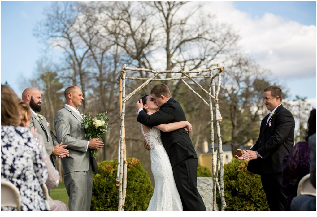 First kiss at the alter - sweet spring wedding than The Bethel Inn