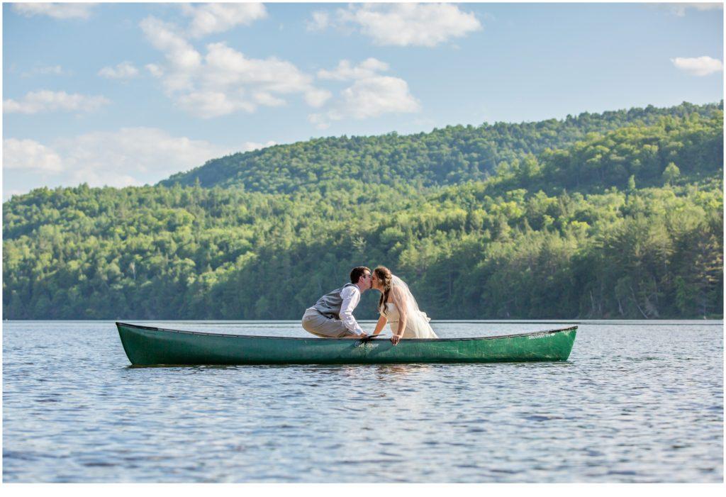 Maine Mountain wedding | Bride and Groom in canoe