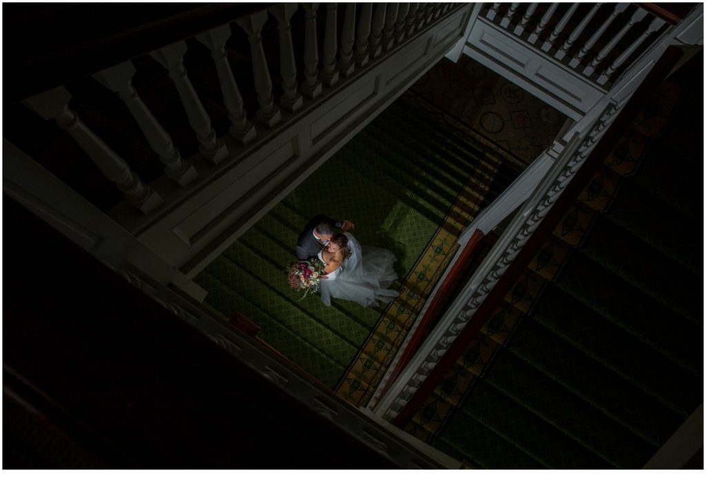 Bride and Groom on the stairs - An Omni Mount Washington Resort Wedding for a Blended Family