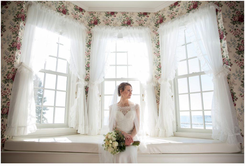 Colony Resort Wedding - Bride in Bay Window