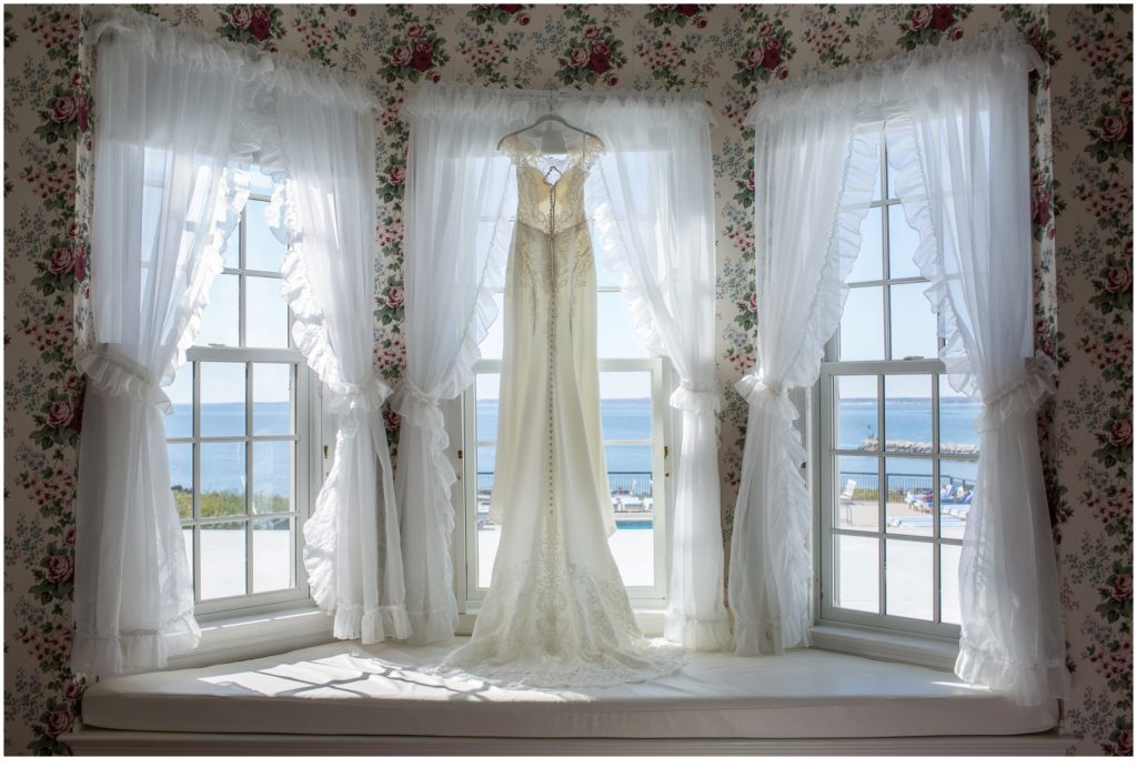Justin and Emily's Colony Resort Wedding - Dress in Bay Window
