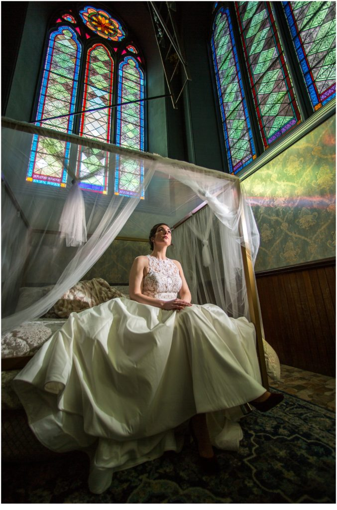 Stained glass windows with the bride on a bed - A Vintage-Inspired Winter Wedding at Agora Grand
